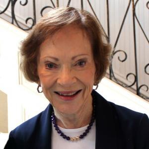Rosalynn Carter in front of staircase